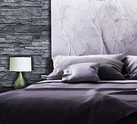Bedroom blended in gray and lack colours. Decorated with Mathios Stone Highland Eclipse.