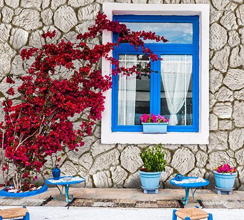 Terra Cream Exterior with a Blue Window